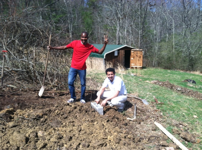 Junior and Nouri leveling out the ground for our foundation.
