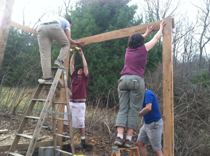 Nouri, Evan, Christina Z and Parakh building the frame for our chicken coop/greenhouse.