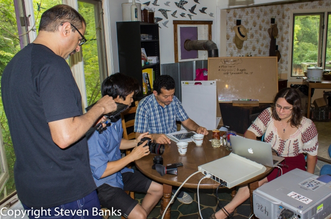 """Parakh Hoon, Dennis Chang, Nouri ElMekharam and Christina Zawerucha set up the technology to """"Think Globally and Act Locally.""""  Each of our PDC sessions are streamed live to Ukraine and translated to Ukrainian and Creole."""