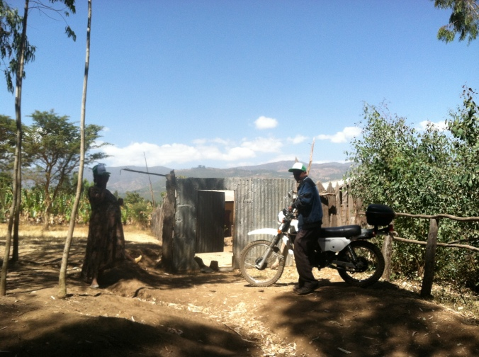 Our partner farmer Hager (in the GreenPath hat) and Amerga Menji and the motorcycle that gets us all over Butajira : )