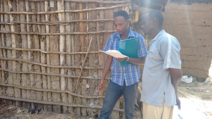 Mickey reviewing the bilingual Regrarian Rubric with one of our partner farmers.